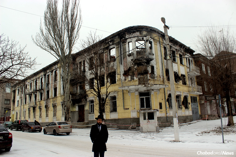 Rabbi Mendel Cohen, chief rabbi and Chabad-Lubavitch emissary in the Ukrainian city of Mariupol, stands in front of the burnt-out shell of the eastern city's central police station. Mariupol saw heavy fighting in the early days of Ukraine's war with Russia-backed separatists and suffered a rocket attack that killed 30 people in January 2015. Fighting has intensified along the frontlines in the last few weeks, rocking Mariupol with the regular sound of heavy artillery and rocket fire.