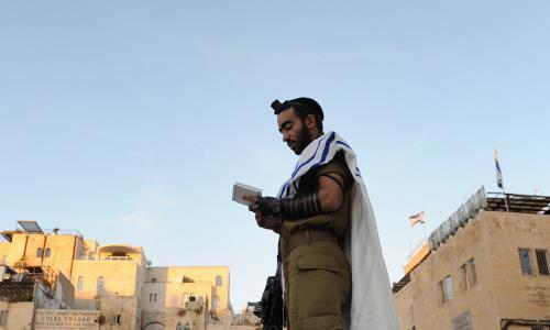 An Israeli soldier wearing tefillin in Jerusalem (Photo: Flash90/Mendy Hechtman)