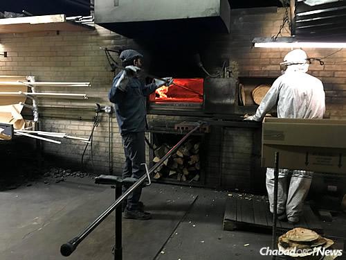 Baking shmurah matzah in Brooklyn, N.Y.