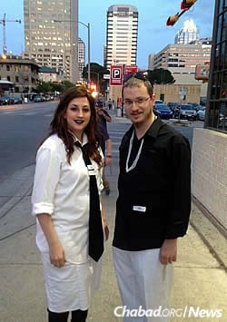 "Rabbi Mendy and Mussy Levertov in Austin, dressed for last year's ""black-and-white"" Purim party"