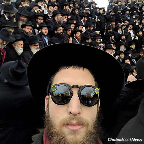 "Lightstone sports ""Spectacles by Snap""—Snapchat sunglasses that record life from the wearer's point of view and can wirelessly transmit photos or video to a cell phone—at the annual fall conference for Chabad-Lubavitch emissaries in Brooklyn, N.Y."