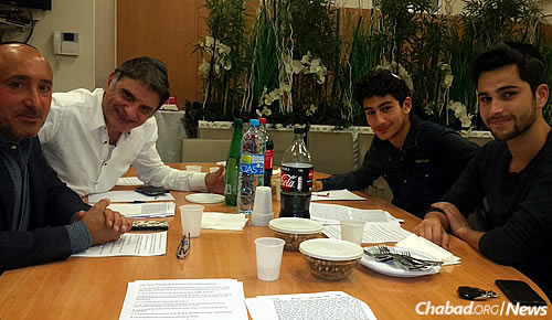 A group of people shown studying in the Chabad House shortly before the nearby attack.