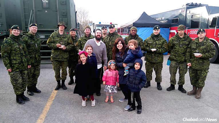 Rabbi Shmuel and Chani Cohen, co-directors of the Chabad Jewish Centre of Kirkland, a suburb on the Island of Montreal, and their children spent Monday, during a break in the weather, serving homemade soup to emergency workers in the wake of widespread flooding.