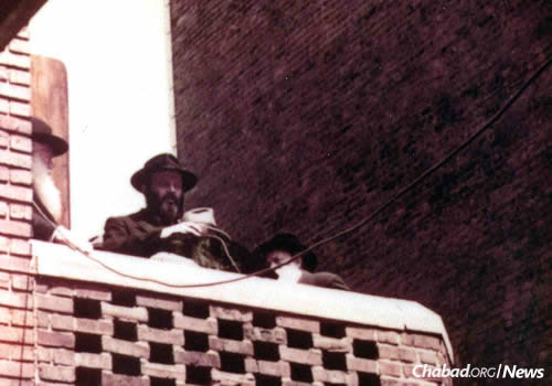 """The Rebbe spoke from a porch in the back courtyard of Chabad-Lubavitch headquarters at 770 Eastern Parkway, a courtyard that later became part of the now famous expanded synagogue. (Photo from the book """"40 Years"""")"""