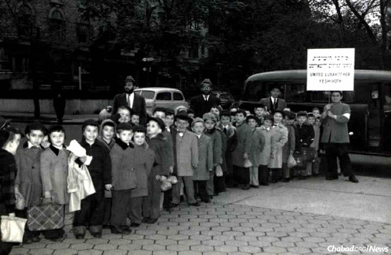 """The first Lag BaOmer parade in 1953 in the Crown Heights neighborhood of Brooklyn, N.Y., left an indelible impression upon 5-year-old Yosef Minkowitz, second from left. The Rebbe—Rabbi Menachem M. Schneerson, of righteous memory—spoke directly to him and other Jewish schoolchildren with a passion Minkowitz recalls to this day. (Photo from the book """"40 Years"""")"""