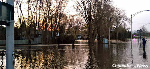 Rising water has caused a state of emergency and thousands to evacuate their homes.
