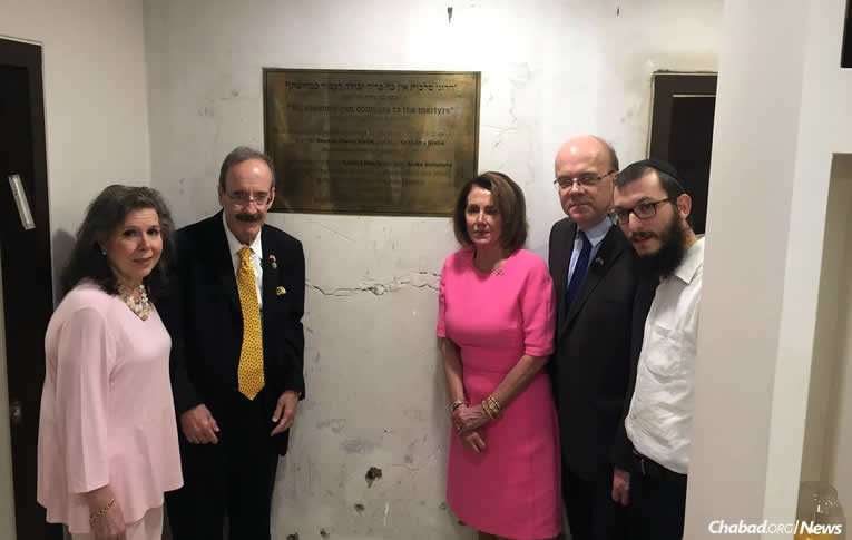 Rabbi Yisroel Kozlovsky, right, co-director of Nariman House, shows the visitors parts of the Chabad center that still bear scars from 2008. From left: Patricia Ennis Engel, New York Congressman Eliot Engel, Minority Leader of the U.S. House of Representatives Nancy Pelosi and Massachusetts Congressman Jim McGovern. (Photo: Jim McGovern/Facebook)