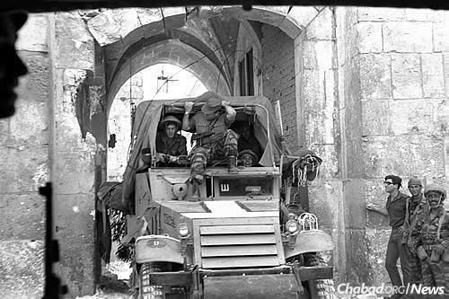 Israeli paratroopers enter the Old City of Jerusalem through Lion's Gate on June 7, 1967, reuniting it after 19 years of Jordanian occupation and placing it under Jewish control for the first time in two millenia. (Photo: Ilan Bruner/Israel Government Press Office)