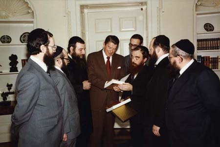 A delegation of Chabad Rabbis make a presentation to the President.