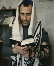 A picture sent to the Rebbe of a Russian Jew in tefillin and saying the Shema in secret
