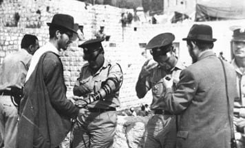 IDF soldiers put on Tefillin at the Western Wall in Jerusalem