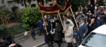 A Torah procession down a street in Basel, Switzerland, marks the dedication of a new Chabad-Lubavitch center in the city. (Photos: Meir Dahan)