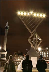 The Chabad House of Hendon's Chanukah menorah at London's Trafalgar Square lights up the night sky. Nelson's Column is in the background.