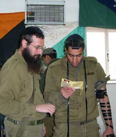 Rabbi Danny Cohen with a soldier