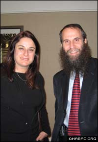 Rona Ramon, left, widow of Israeli astronaut Ilan Ramon, attended a farbrengen in honor of Jewish astronaut Garret Reisman presided over by Chabad-Lubavitch Rabbi Zvi Konikov.