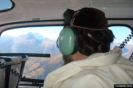 Rabbi Mendel Goldstein, co-director of Chabad-Lubavitch of New Zealand, surveys the area around Queenstown, New Zealand, for signs of missing Israeli backpacker Liat Tess-Okin in the days before Passover.