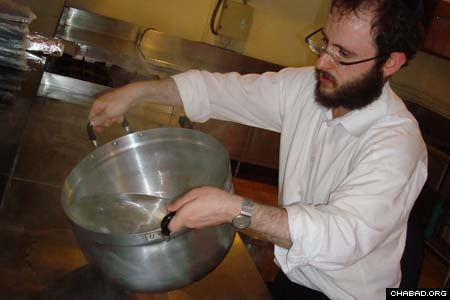 A Chabad-Lubavitch rabbinical student koshers a pot in Phuket, Thailand, in preparation for Passover.