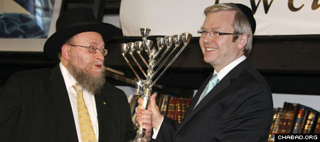Chabad-Lubavitch Rabbi Pinchus Feldman, left, dean and spiritual leader of Sydney's Yeshiva Centre, presents a silver menorah to Australian Prime Minister Kevin Rudd.