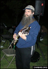 Chabad-Lubavitch Rabbi Menachem Schmidt plays the guitar at a Lag B'Omer celebration in Philadelphia hosted by Chabad-Lubavitch of Northern Liberties.