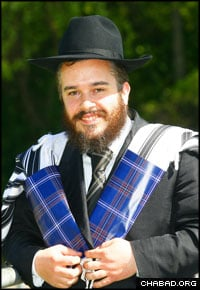 Scottish-born Rabbi Mendel Jacobs, director of The Shul in the Park in Giffnock, models the new Jewish tartan, here used to keep a tallit bundled together.