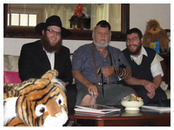 Peter put on Tefillin as we and his stuffed animals looked on.