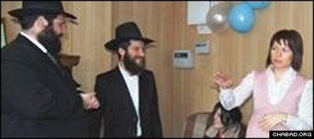 Chief Rabbi of Krasnoyarsk, Russia, Benyamin Wagner, center, listens to a presentation by a member of the Jewish community of Achinsk.