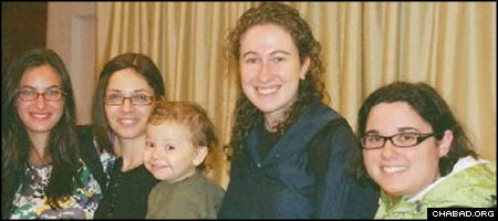 Rivka Holtzberg, second from left, and her son Moshe pose for a picture with some young women who had come to their Mumbai, India, Chabad House.