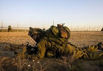 An AP photo of Avraham Meir Ostfeld on actual duty