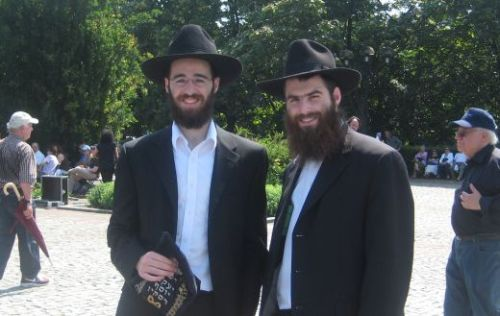 Tefillin in hand, Dovid Blecher and Yaakov Yosef Raskin are ready to rove!