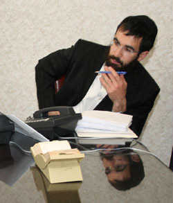 Always at his desk and ready to help, Rabbi Schneor Nejar.
