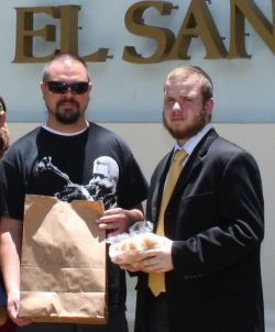 A Jewish tourist from Palm Springs, CA receives his kosher delivery at the El San Juan Hotel.
