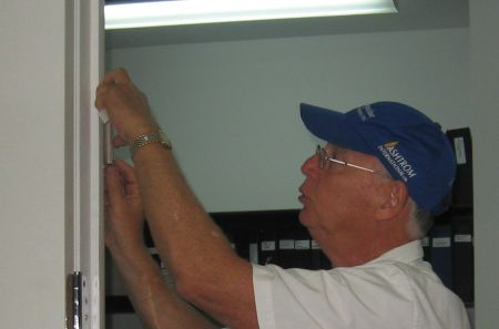 Installing a mezuzah in the office of an Israeli construction company.
