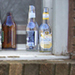 Empty Bottles on a Window Ledge