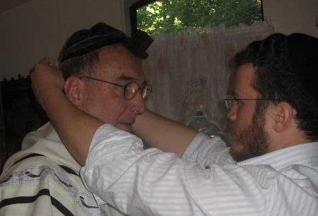 We help Bob don tefillin.