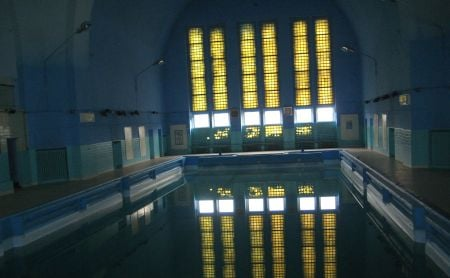 These same windows which presided over Jewish prayers for so many years now overlook a swimming pool.