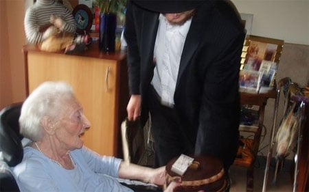 We help an elderly Holocaust survivor celebrate her birthday.
