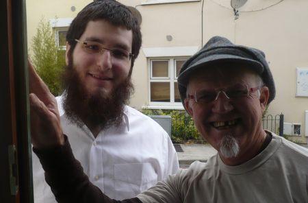 Installing a mezuzah on Patrick's front door.