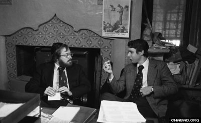 Cardiologists Ira Weiss (right) and Louis Teichholz confer in the office of the Rebbe's secretariat.
