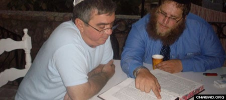 Rabbi Chaim Azimov and a Jewish resident of North Cyprus tackle an ancient text.