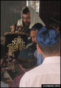 Rabbi Mendel Zarchi, center, ensured the presence of kosher provisions on board the vessel.