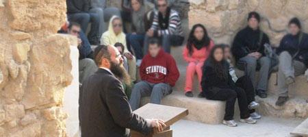 Rabbi Shimon Elharar addresses a squadron of Israeli pilots atop the desert mountain fortress of Masada.