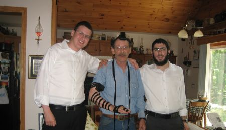 Alan, in tefillin, in his living room.