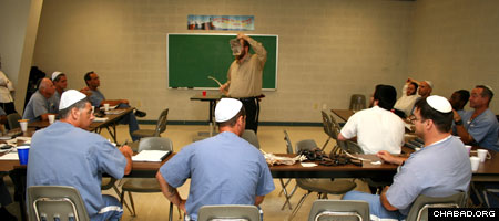 A volunteer with the Chabad-Lubavitch run Aleph Institute leads a Torah class for Jewish prisoners at the Dade Correctional Institution in Florida City, Fla.