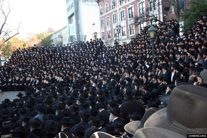 Thousands of Chabad-Lubavitch emissaries from more than 76 countries arrived in Brooklyn, N.Y., for their annual conference. They gathered Sunday morning in front of Lubavitch World Headquarters for the traditional group photograph.