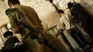 soldier praying cropped.jpg