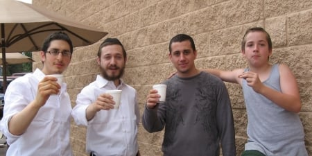 Toasting to the bar mitzvah at the gas station.