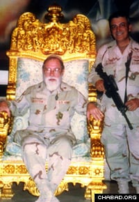Chaplain Goldstein sits in a gold throne found in Saddam Husseins palace in Baghdad.
