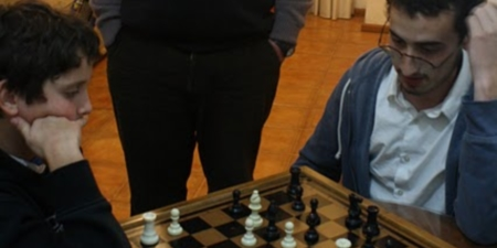 He is 12 years old and a chess champion. Can you guess who showed whom a thing or two?