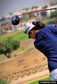 Laetitia Beck swings at the 2010 Caesarea Golf Club Championship. (Photo: Yoav Etiel/Hamoshavot Magazine)