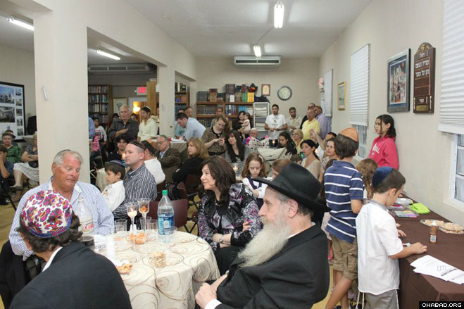 More than 125 Jewish residents and tourists pack Chabad-Lubavitch of Puerto Rico for the arrival and dedication of its third Torah scroll.